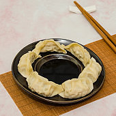 Steamed dumplings served with soy sauce.  Dim Sum. Jiaozi.