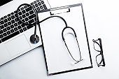 Medical equipment and technology concept. Laptop and stethoscope.