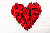 Beautiful bright red rose petals, romantic gesture, background. Happy valentines day oliday sales concept.