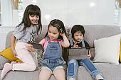 children watching cartoon on digital tablets and smart phone