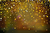 Falling golden stars on dark background. Golden Stars Confetti. Christmas, New Year celebration holiday background.