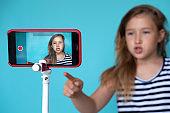 Girl posing in front of phone camera for selfie