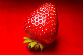 Strawberry closeup. Macro image of fresh strawberries on red background