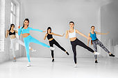 A group of women dancing in the gym. The concept of sports, a healthy lifestyle, fitness, stretching and dancing