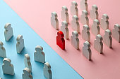 The conflict between the two business teams. One group of people with a leader stands as a unit, and the other group of people stands as a crowd