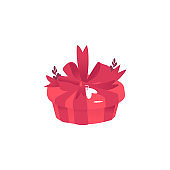 Red round gift box with large bow, ribbon and sticker in form of heart for greeting sign.
