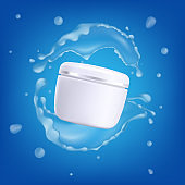 White plastic can of moisturizing cream or gel in water splashes and drops.