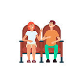 Smiling couple sitting in cinema chairs cartoon style