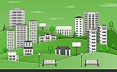 Green city skyline with multistorey apartment houses and office buildings, benches and lampposts.