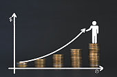 stack coin in dark background with chalk draw graph growth up and human on top. interest financial investment concept and saving money success.