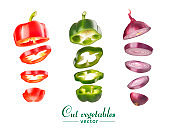 Set of vegetables of bell pepper and onions. Vegetables are cut