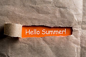 Hello Summer. June 1st. Image of congratulations on the first month of summer in torn envelope background. Childrens Day