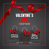 Valentines Day Sale. Realistic Paper shopping bag with handles and red bow, ribbon, isolated on dark background. Vector illustration