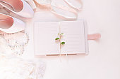 Wedding flat lay, womans stylish fashion accessories in biege colors, white background,copy space.Bridal details concept