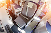 Comfortable passenger seats in the cabin of airplane.