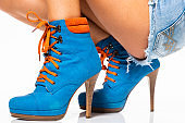 female blue boots in a fashion show