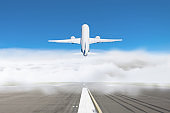 Take-off passenger plane from a cloud of fog at the airport, concept of delayed flights in bad weather.