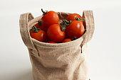 Bag full of cherry tomatoes.