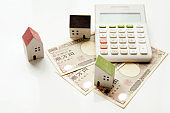 Toy house and calculator.