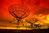 The silhouette of a radio telescope observatory