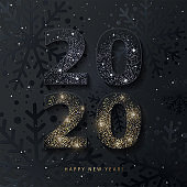 2020 Happy New Year background. 2020 number design with glittering black and gold numbers on textured black background with snowflakes pattern and shining snow sparkles