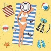 Pretty girl is lying on the beach