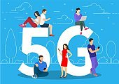 People with gadgets sitting on the big 5G symbol.