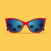 Modern sunglasses with palms reflection.
