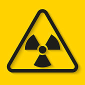Danger radioactive sign on yellow background. Vector illustration