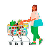 Woman with a grocery cart in the supermarket. Buying food. Customer at a retail grocery store