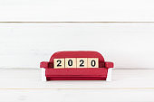 Upcoming 2020 New Year , Number Wooden Block on Sofa over white wood background.