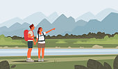 Happy couple of young people go hiking. Man and woman with backpacks on a background of mountainous landscape