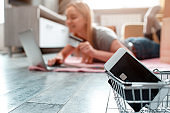 Online shopping at home. Credit card and smartphone are ready for Single day sale on a background of a shopper with laptop
