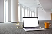 Laptop on the floor at new empty office