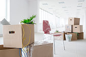 Cardboard boxes in new empty office