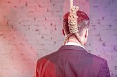 Rear view of businessman with noose at office