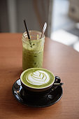 Iced green tea latte and hot green tea latte with froth art