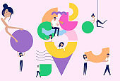 Illustration of group of people organizing and arranging abstract geometric shapes.