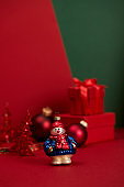 Christmas snowman on red and green background with Christmas decoration.