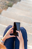 woman's hands using a mobile phone on the street