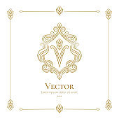 Golden shield emblem. V letter. Elegant, classic vector. Can be used for jewelry, beauty and fashion industry. Great for logo, monogram, invitation, flyer, menu, background, or any desired idea.