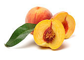 Isolated leaves and peaches in half white