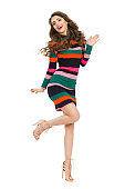Fashion Model In Striped Dress Is Standing On One Leg And Laughing