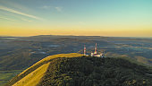 Landscape with communications tower in mountains at sunset, Nanos, Slovenia