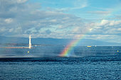 Lighthouse and rainbow over Lake Geneva.