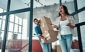 Couple moving in new home.