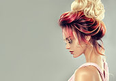 Attractive woman is demonstrating multi colored hair gathered in elegant wedding hairstyle.