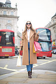 Fashionable girl doing shopping in London