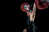 Young man lifting barbell