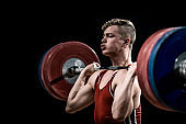 Young weightlifter holding barbell